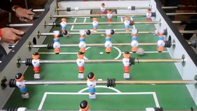 Playing Foosball. Two people emotionally actively playing foosball closeup stock video footage