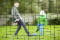 Playing football during autumnal time Royalty Free Stock Image