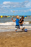 Playing football on the beach. Two boys playing football on the beach on a sunny day Stock Images