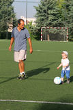 Playing football with dad Royalty Free Stock Images