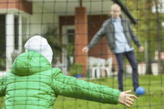Playing football in a garden Royalty Free Stock Images