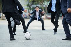 Playing Football at Lunchtime Royalty Free Stock Photography