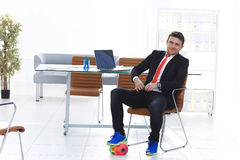 Playing football in office. Business man playing football in his office Stock Photos