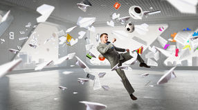 Playing football in office . Mixed media Royalty Free Stock Photos