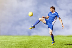 Playing football player Stock Images