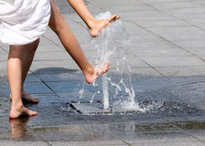 Playing with fountain Royalty Free Stock Image