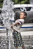 Playing with fountain Royalty Free Stock Photography
