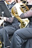She is playing a french horn. stock photo