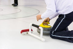 Playing a game of curling. Royalty Free Stock Photos