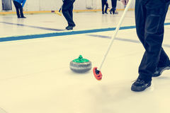 Playing a game of curling. Stock Image