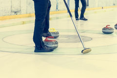 Playing a game of curling. Indoor sport played on ice Stock Photography
