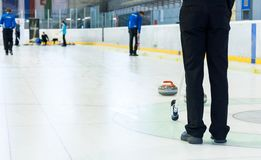 Playing a game of curling. Indoor sport played on ice Stock Images