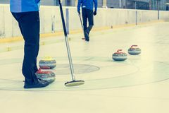 Playing a game of curling. Indoor sport played on ice Royalty Free Stock Images