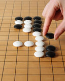 Playing the game of Go Royalty Free Stock Photos