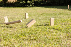 Playing a game of kubb royalty free stock photography