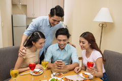 Playing game on smartphone Stock Photography