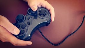 Playing Games with Analog Joy Stick in Hand Stock Photo