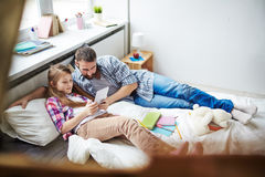 Playing games on digital tablet Stock Photos