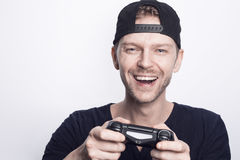 Playing games. Happy man playing game on console stock photo