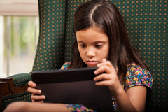Playing games on a tablet computer Royalty Free Stock Photo