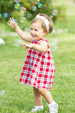 Playing in the garden baby girl Royalty Free Stock Images