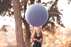 Playing girl with balloon Stock Photo