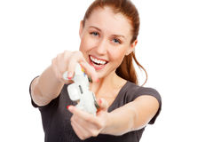 Playing girl with a game controller Royalty Free Stock Photos