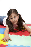 Playing girl on rubber foam carpet Royalty Free Stock Images