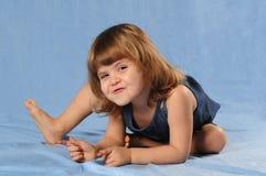 Playing girl in studio Stock Photography