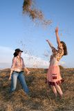 Playing girls  in hay Stock Photos