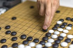 Playing Go or Igo, Chinese board game Stock Photos