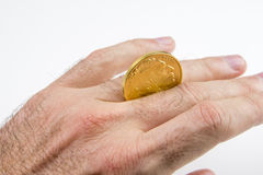 Playing with gold coin on fingers Royalty Free Stock Photos