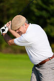 Playing Golf – hit the ball Stock Photography