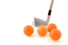 Playing golf. With club and many balls Royalty Free Stock Images