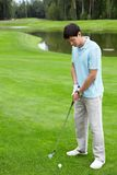 Playing golf. A young man playing golf Royalty Free Stock Photo