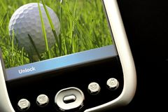 Playing Golf. On PDA stock images