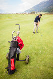 Playing golf alone Stock Images