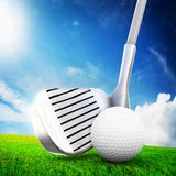 Playing golf. Ball on tee, golf club. Playing golf. Ball, a golf club ready to shot. Sunny summer scene Royalty Free Stock Photo