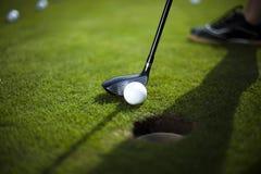 Playing golf, ball Stock Photography