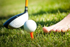 Playing golf barefoot Stock Photos