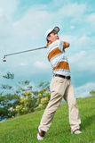 Playing the golf. Full-length image of a man playing golf outside Stock Image
