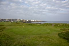 Playing golf at golf course with picturesque scenery, County Kerry, Ireland royalty free stock photo