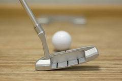 Playing golf in the house or office royalty free stock photos