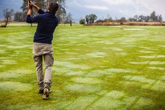Playing golf in the morning Royalty Free Stock Image