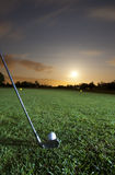 Playing golf at night Royalty Free Stock Images