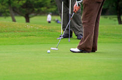 Playing golf scenery. Man playing golf on irish course Royalty Free Stock Image