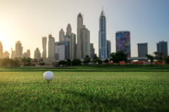 Playing golf at sunset. Golf ball is on the tee for a golf ball Royalty Free Stock Image