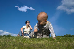 Playing on the grass Stock Images