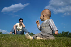 Playing on the grass Royalty Free Stock Images