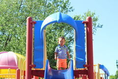 Playing on the Slide.  Royalty Free Stock Photos